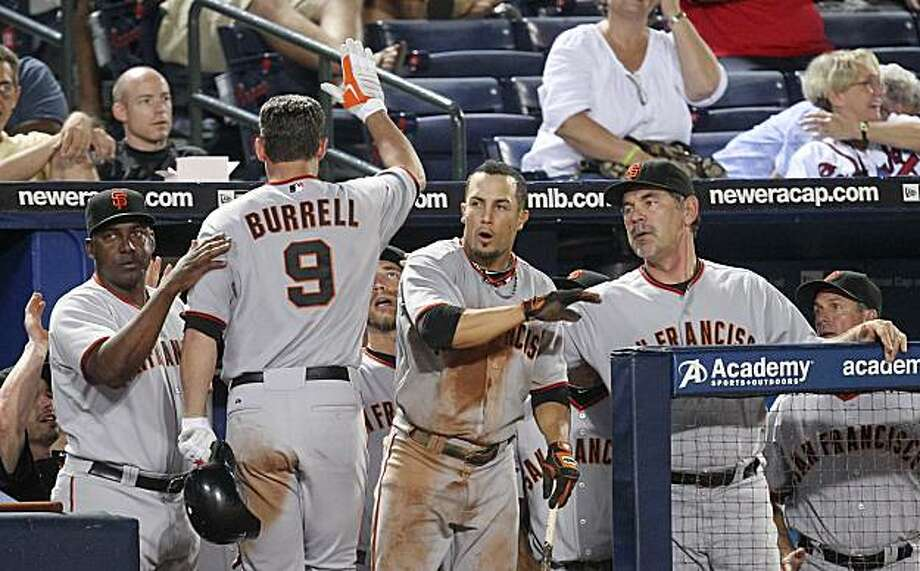 San Francisco Giants left fielder Pat Burrell (9) is greeted at the dugout entrance after driving in the game-winning run with a sacrifice fly in the 11th inning of a baseball game Friday, Aug. 6, 2010, in Atlanta.  The Giants won 3-2. Photo: John Bazemore, AP