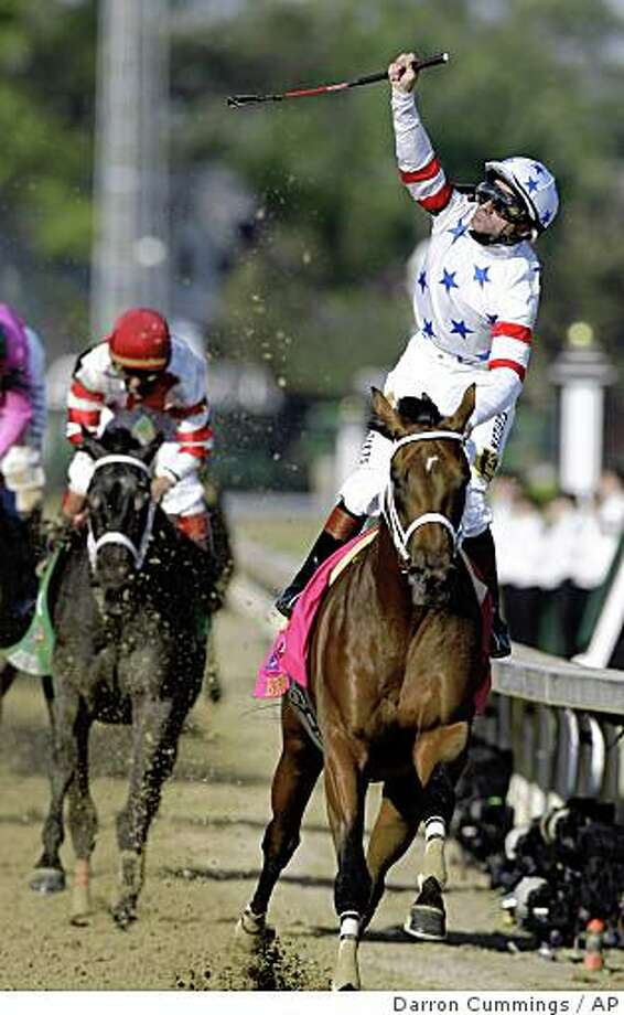 ** FILE ** In this May 3, 2008 file photo, Kent Desormeaux rides Big Brown to a victory in the 134th Kentucky Derby at Churchill Downs in Louisville, Ky. Big Brown most likely will miss the Breeders' Cup Classic after injuring his right front foot during a workout at Aqueduct on Monday Oct. 13, 2008. The Classic was expected to be Big Brown's final race before he was retired to stud. (AP Photo/Darron Cummings) Photo: Darron Cummings, AP