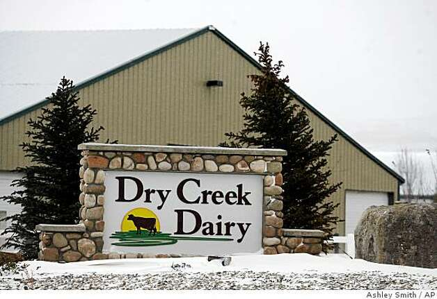 ** FOR RELEASE DEC. 20-21 ** The entrance to Dry Creek Dairy, a Bettencourt dairy southwest of Murtaugh, Idaho on Friday, Dec. 19,2008.That odor wafting from 550,000 cows that make up Idaho's growing dairy herd smells like energy independence and economic development to state energy czar Paul Kjellander. (AP Photo/Ashley Smith) Photo: Ashley Smith, AP