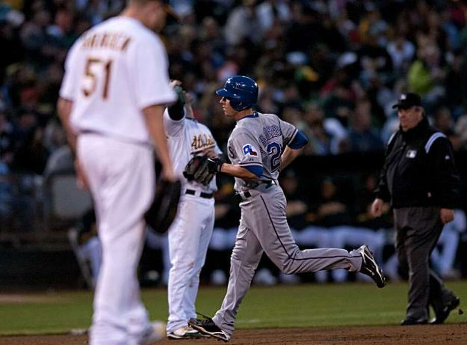 Rangers catcher Taylor Teagarden rounds third base after hitting a home run off of Dallas Braden in Oakland on Friday. Photo: Chad Ziemendorf, The Chronicle