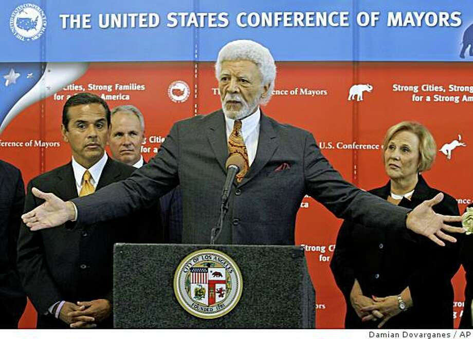 U.S. Conference of Mayors members Los Angeles Mayor Antonio Villaraigosa, left, Oakland Mayor Ron Dellums, center, and Gastonia, N.C. Mayor Jennifer Stultz hold a news conference at the Mayors 08 Action Forum on Poverty held at the Maxine Waters Employment Preparatory Center in Los Angeles on Wednesday, Sept. 24, 2008. (AP Photo/Damian Dovarganes) Photo: Damian Dovarganes, AP