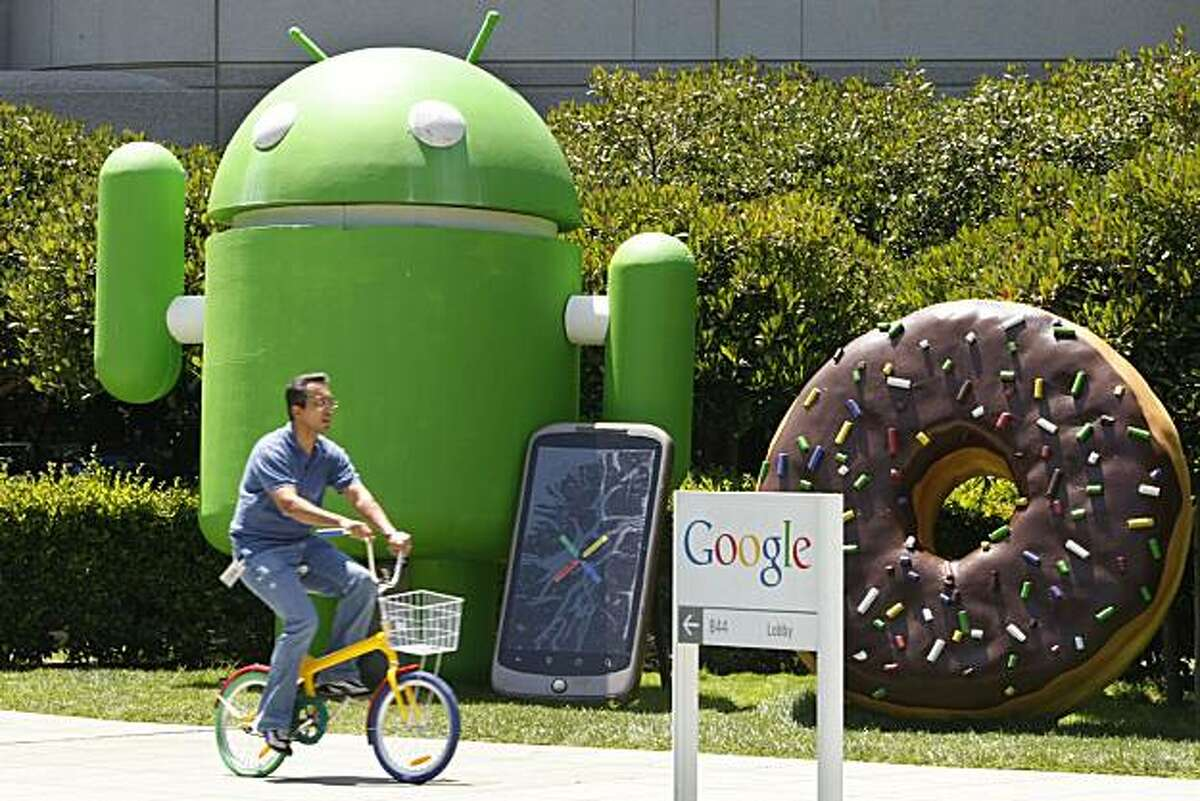 This photo made July 13, 2010, shows a Google worker riding a bike at the company's headquarters in Mountain View, Calif. Google Inc. reports its second-quarter earnings, Thursday, July 15, after the market closes.