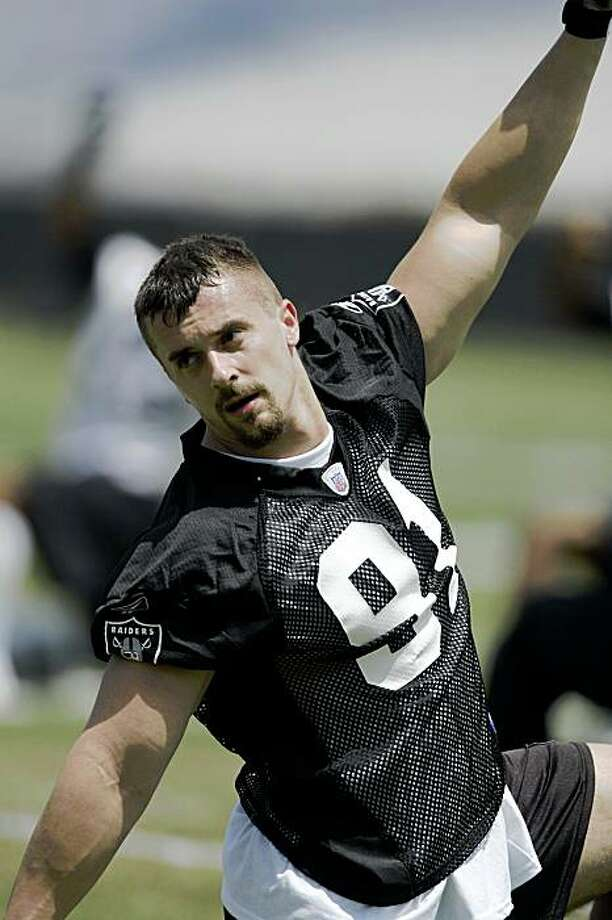** FILE ** In this May 9, 2008 file photo, Oakland Raiders' Trevor Scott stretches during football practice at Raiders minicamp in Alameda, Calif. Scott had his first two career sacks last week against the New York Jets as the Raiders managed to pressure Brett Favre frequently despite the absence of two-time Pro Bowler Derrick Burgess. (AP Photo/Ben Margot, File) Photo: Ben Margot, AP