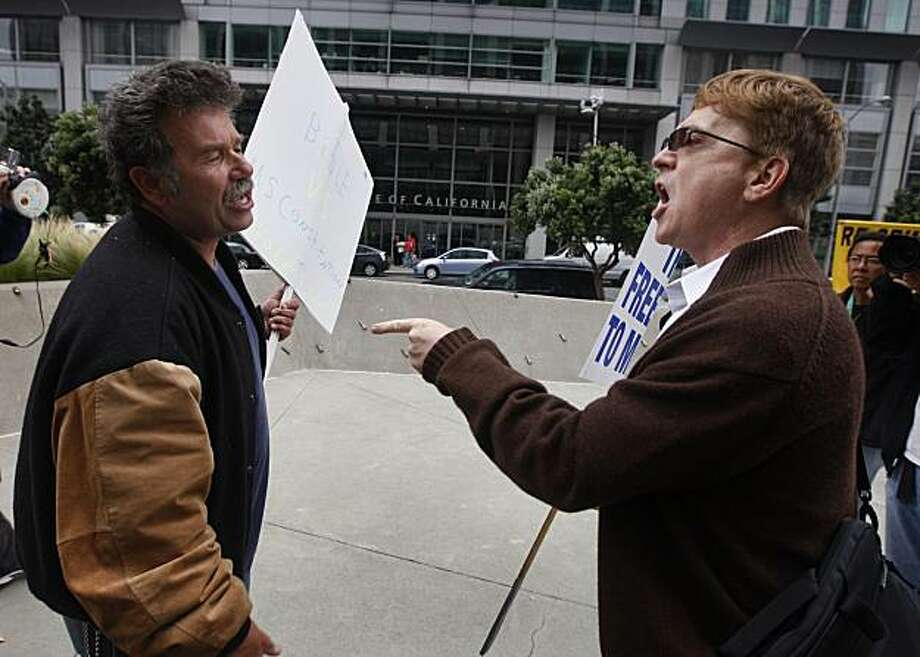 Proposition 8 supporter Mark Wassberg (left) and same-sex supporter Ron Weaver exchange points of view at the Phillip Burton Federal Building before Chief U.S. District Court Judge Vaughn Walker issues his ruling on the constitutionality of Proposition 8 in San Francisco, Calif., on Wednesday, Aug. 4, 2010. Photo: Paul Chinn, The Chronicle