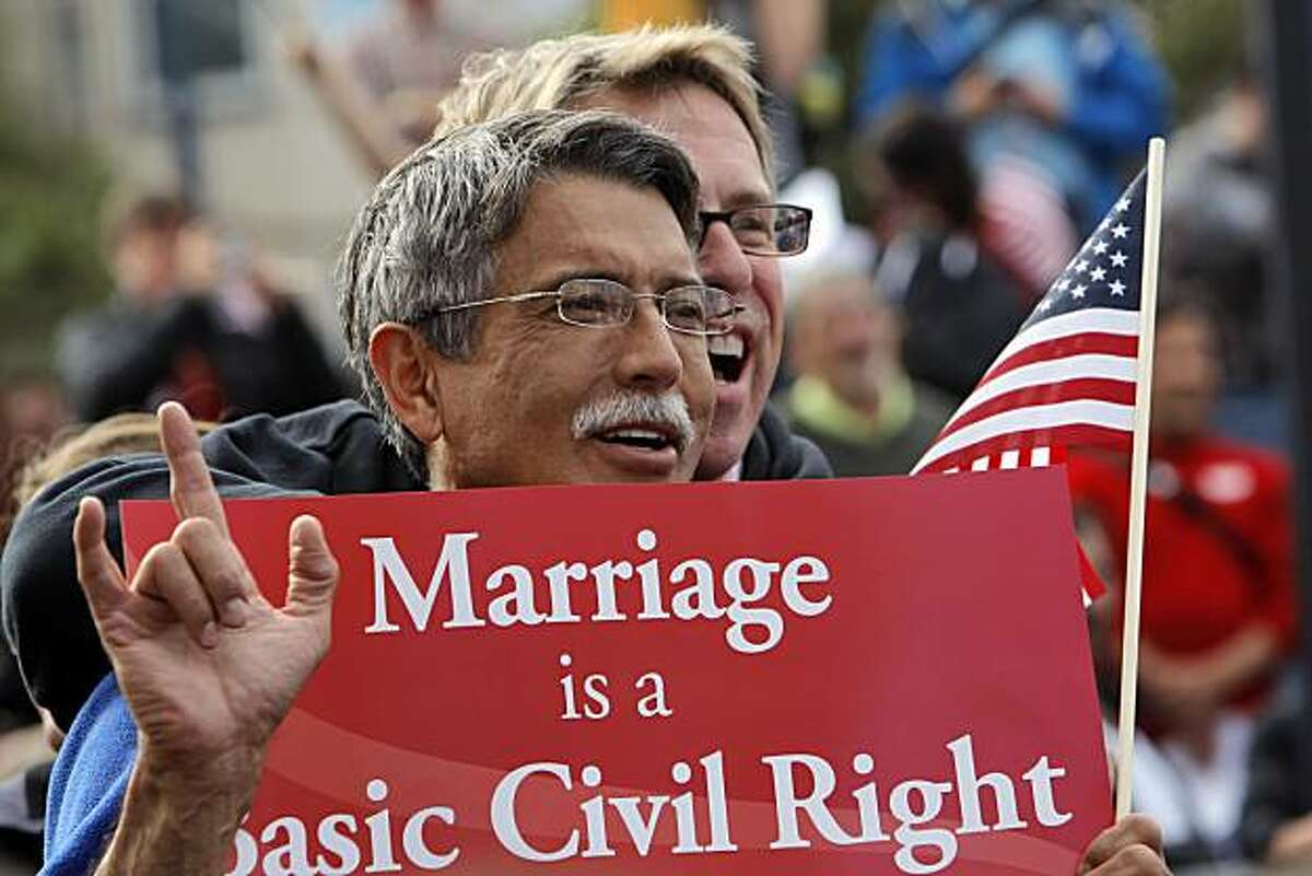 Michael Harriman, front, and his partner, Stan May, of San Francisco, cheer during the victory speeches at the corner of Market and Castro Streets on Wednesday. Supporters of same-sex marriage gathered in the Castro District of San Francisco, Calif., to celebrate a federal judge's ruling that Proposition 8 was unconstitutional and was being struck down on Wednesday, August 4, 2010. Those gathered in the neighborhood then marched to City Hall for a rally celebrating the decision.