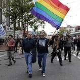 Richard Griffin, left, and Kenny Vick, right, march along Market Street on Wednesday. Supporters of same-sex marriage gathered in the Castro District of San Francisco, Calif., to celebrate a federal judge's ruling that Proposition 8 was unconstitutional and was  being struck down on Wednesday, August 4, 2010. Those gathered in the neighborhood then marched to City Hall for a rally celebrating the decision.