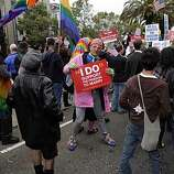 Bruce Beaudette, center, dances as the march stops on Market Street on Wednesday. Supporters of same-sex marriage gathered in the Castro District of San Francisco, Calif., to celebrate a federal judge's ruling that Proposition 8 was unconstitutional and was  being struck down on Wednesday, August 4, 2010. Those gathered in the neighborhood then marched to City Hall for a rally celebrating the decision.