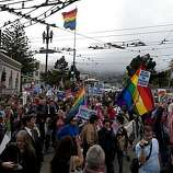Supporters of the overturning of Proposition 8 march down Market Street in San Francisco, Calif., on Wednesday, August 04, 2010.