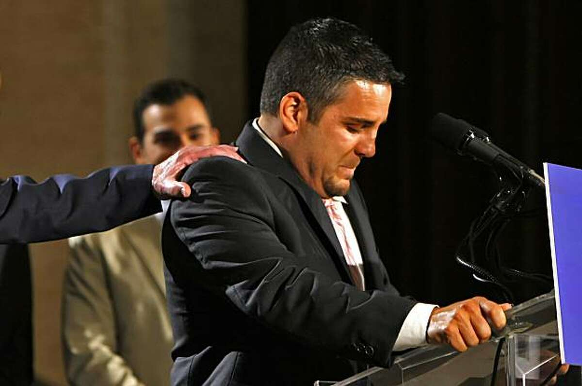 Plaintiffs Jeff Zarillo gets emotional and in consoled by attorney David Boies, as he addresses the media after hearing that Chief Judge Walker ruled in favor of the Perry v. Schwarzenegger case, striking down California's Proposition 8, Wednesday Aug.4, 2010, in San Francisco, Calif. Plainttiff Paul Katami, Jeff's boyfriend stands in the background.
