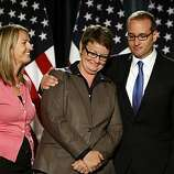 American Foundation for Equal Rights Board President Chad Griffin, right gives plaintiff Kristin Perry a squeeze congratulation her and her partner Sandra Stier, left, in the judges rule in favor of the Perry v. Schwarzenegger case, striking down California's Proposition 8, Wednesday Aug.4, 2010, in San Francisco, Calif.