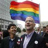 Stuart Gaffney (left) and his husband John Lewis wait at the Philip Burton Federal Building for Chief U.S. District Court Judge Vaughn Walker to issue his ruling on the constitutionality of Proposition 8 in San Francisco, Calif., on Wednesday, Aug. 4, 2010.