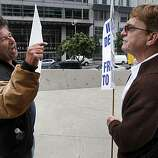 Proposition 8 supporter Mark Wassberg (left) and same-sex supporter Ron Weaver exchange points of view at the Phillip Burton Federal Building before Chief U.S. District Court Judge Vaughn Walker issues his ruling on the constitutionality of Proposition 8 in San Francisco, Calif., on Wednesday, Aug. 4, 2010.
