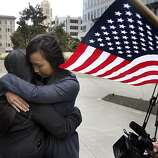 Maria Ydil and her fiancee Vanessa Judicpa embrace at the Philip Burton Federal Building before Chief U.S. District Court Judge Vaughn Walker issues his ruling on the constitutionality of Proposition 8 in San Francisco, Calif., on Wednesday, Aug. 4, 2010. Ydil and Judicpa will be married Saturday after planning their wedding since January.