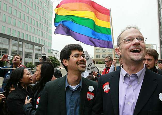 Same-sex couple Stuart Gaffney (left) and John Lewis wait to hear the ruling on Prop 8 outside of the Philip Burton Federal building  August 4, 2010 in San Francisco, California.US District Judge Vaughn Walker announced his rulingto overturn Prop 8 finding it unconstitutional. The voter approved measure denies same-sex couples the right to marry in the State of California. Photo: Justin Sullivan, Getty Images