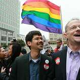 Same-sex couple Stuart Gaffney (left) and John Lewis wait to hear the ruling on Prop 8 outside of the Philip Burton Federal building  August 4, 2010 in San Francisco, California.US District Judge Vaughn Walker announced his rulingto overturn Prop 8 finding it unconstitutional. The voter approved measure denies same-sex couples the right to marry in the State of California.