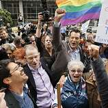 Opponents of Proposition 8 cheer after hearing the decision in the United States District Court proceedings challenging Proposition 8 outside of the Phillip Burton Federal Building in San Francisco, Wednesday, Aug. 4, 2010. in San Francisco, Wednesday, Aug. 4, 2010. A federal judge overturned California's same-sex marriage ban Wednesday in a landmark case that could eventually land before the U.S. Supreme Court to decide if gays have a constitutional right to marry in America.