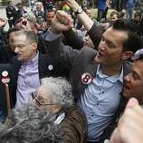 Stuart Gaffney, from left, his husband John Lewis, Spencer Jones, and his husband Tyler Barrick celebrate after hearing the decision in the United States District Court proceedings challenging Proposition 8 outside of the Phillip Burton Federal Building in San Francisco, Wednesday, Aug. 4, 2010.   A federal judge overturned California's same-sex marriage ban Wednesday in a landmark case that could eventually land before the U.S. Supreme Court to decide if gays have a constitutional right to marry in America.