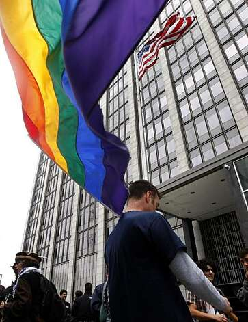 Kenny Vick waves a rainbow flag at the Phillip Burton Federal Building before Chief U.S. District Court Judge Vaughn Walker issues his ruling on the constitutionality of Proposition 8 in San Francisco, Calif., on Wednesday, Aug. 4, 2010. Photo: Paul Chinn, The Chronicle