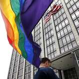 Kenny Vick waves a rainbow flag at the Phillip Burton Federal Building before Chief U.S. District Court Judge Vaughn Walker issues his ruling on the constitutionality of Proposition 8 in San Francisco, Calif., on Wednesday, Aug. 4, 2010.