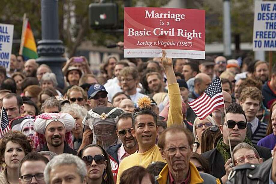 Same sex marriage supporters hold a rally in the Castro district after US District Judge Vaughn Walker announced his ruling to overturn Prop 8 finding it unconstitutional August 4, 2010 in San Francisco, California. The voter approved measure denies same-sex couples the right to marry in the State of California. Photograph by David Paul Morris/Special to the Chronicle Photo: David Paul Morris, Special To The Chronicle