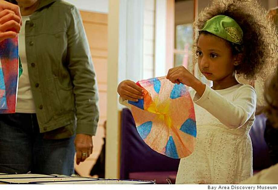 At the Discovery Museum's Kwanzaa celebration, art programs include kids painting a collaborative mural, while an African Roots of Jazz CD plays in the background. Photo: Bay Area Discovery Museum