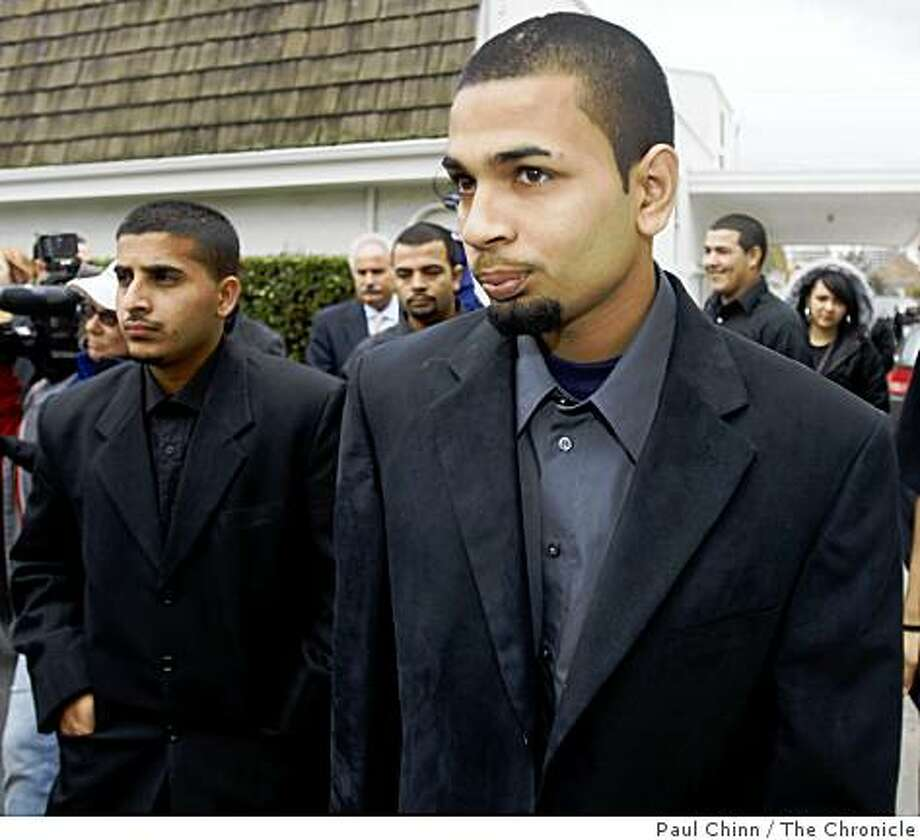 Paul Dhaliwal (right) one of the two brothers injured in the tiger attack, leaves the funeral service for 17-year-old Carlos Sousa, Jr. in San Jose, Calif. on Tuesday, Jan. 8, 2008. Sousa was killed in the Christmas Day tiger attack at the San Francisco Zoo Photo: Paul Chinn, The Chronicle