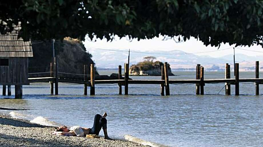 Andrea Keogh from San Rafael Ca relaxes on the beach next to the China Camp pier. Day-trippers have enjoyed China Camp in Marin County for years. It's very popular with hikers, cyclist an picnickers, not to forget boaters. Wednesday July 28, 2010. Photo: Lance Iversen, The Chronicle