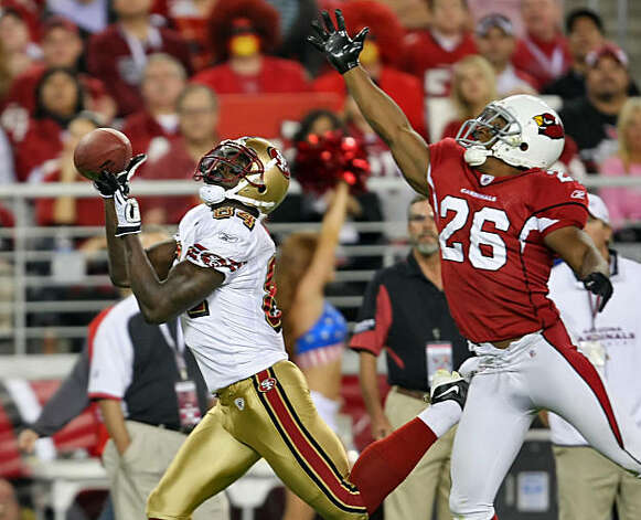 San Francisco 49ers Josh Morgan catches a touchdown pass with Cardinals Roderick Hood on his heels in the second quarter of the game, Monday Nov. 10, 2008, in Phoenix. Photo: Lacy Atkins, The Chronicle