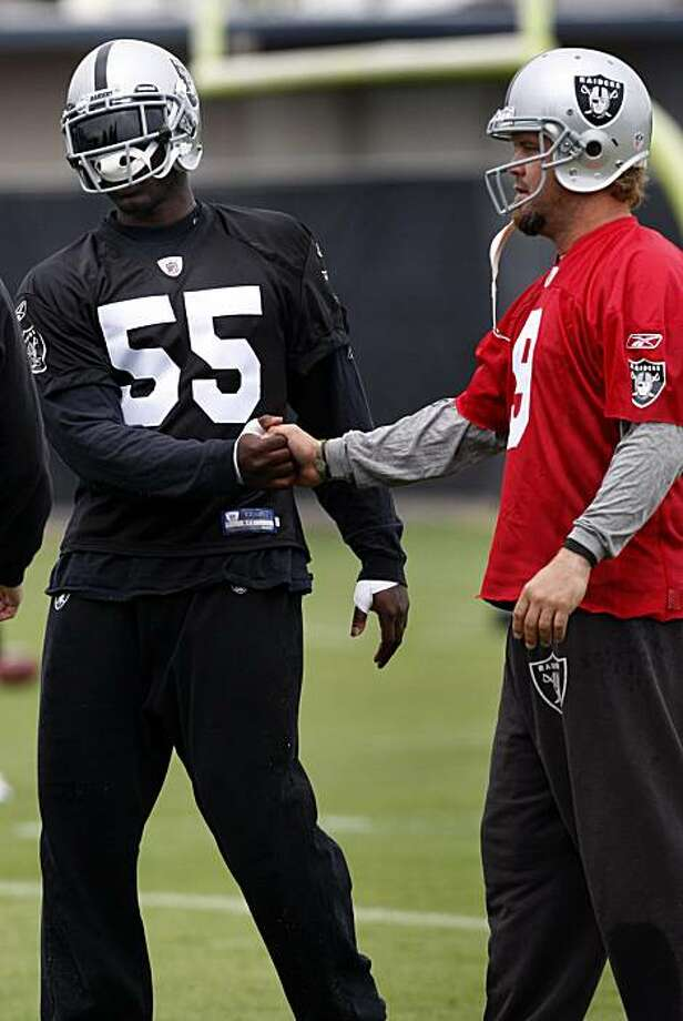 Punter Shane Lechler (right) welcomes first round draft pick Rolando McClain (55) to the team during the first practice session of summer training camp for the Oakland Raiders in Napa, Calif., on Thursday, July  29, 2010. Photo: Paul Chinn, The Chronicle