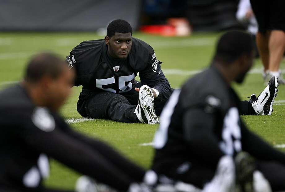 First round draft pick Rolando McClain stretches with his new teammates during the first practice session of summer training camp for the Oakland Raiders in Napa, Calif., on Thursday, July  29, 2010. The rookie linebacker from Alabama signed his contract with the Raiders on Wednesday. Photo: Paul Chinn, The Chronicle