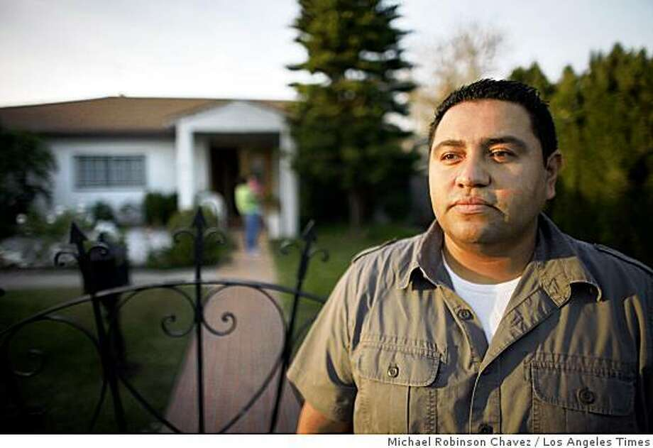 "Jose Hernandez, 28, may lose his family's home in the Los Angeles' San Fernando Valley. ""If we come together as a community, maybe we have a chance,"" he said. Illustrates MORTGAGE-CHURCH (category a) by Jessica Garrison (c) 2008, Los Angeles Times. Moved Wednesday, Dec. 10, 2008. (MUST CREDIT: Los Angeles Times photo by Michael Robinson Chavez.) Jose Hernandez, 28, may lose his family's home in the Los Angeles' San Fernando Valley. ""If we come together as a community, maybe we have a chance,"" he said. Illustrates MORTGAGE-CHURCH (category a) by Jessica Garrison (c) 2008, Los Angeles Times. Moved Wednesday, Dec. 10, 2008. (MUST CREDIT: Los Angeles Times photo by Michael Robinson Chavez.) Photo: Michael Robinson Chavez, Los Angeles Times"