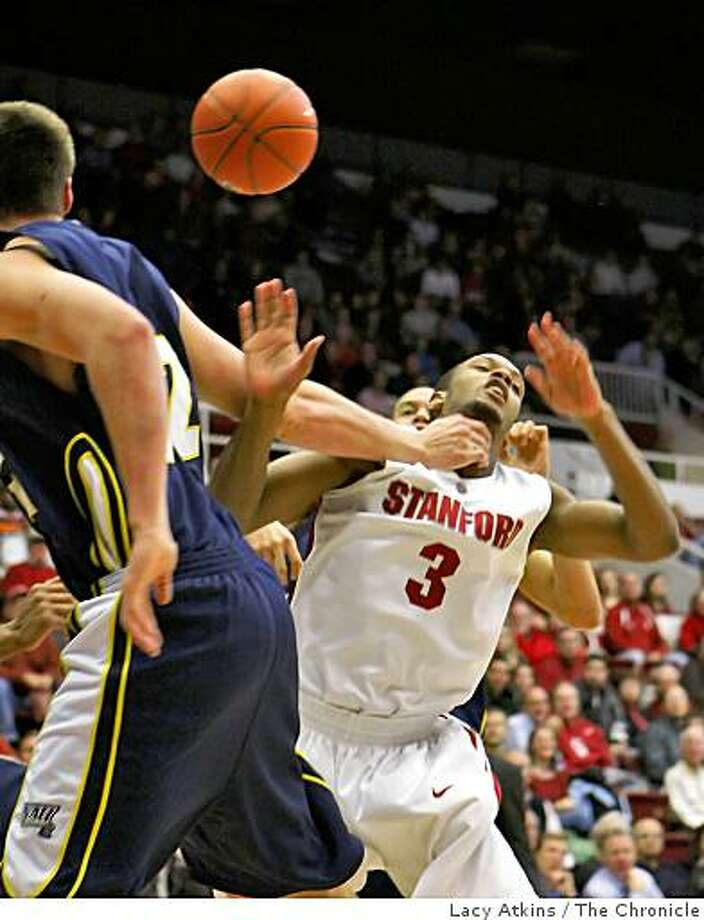 Northern Arizona Lumberjacks Nick Larson (left), fouls Stanford Cardinal Jarrett Mann in the first half of the game, Wednesday Dec. 17, 2008, in Stanford, Calif. Photo: Lacy Atkins, The Chronicle