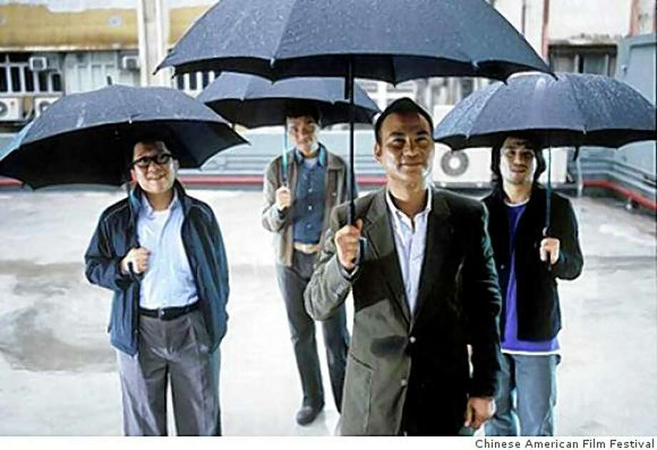 """Simon Yam (foreground) and, from left, Law Wing Cheong, Gordan Lam and Kenneth Cheung in Johnnie To's """"Sparrow,"""" a 2008 Hong Kong film. Photo: Coutesy 4 Star Theater, Chinese American Film Festival"""