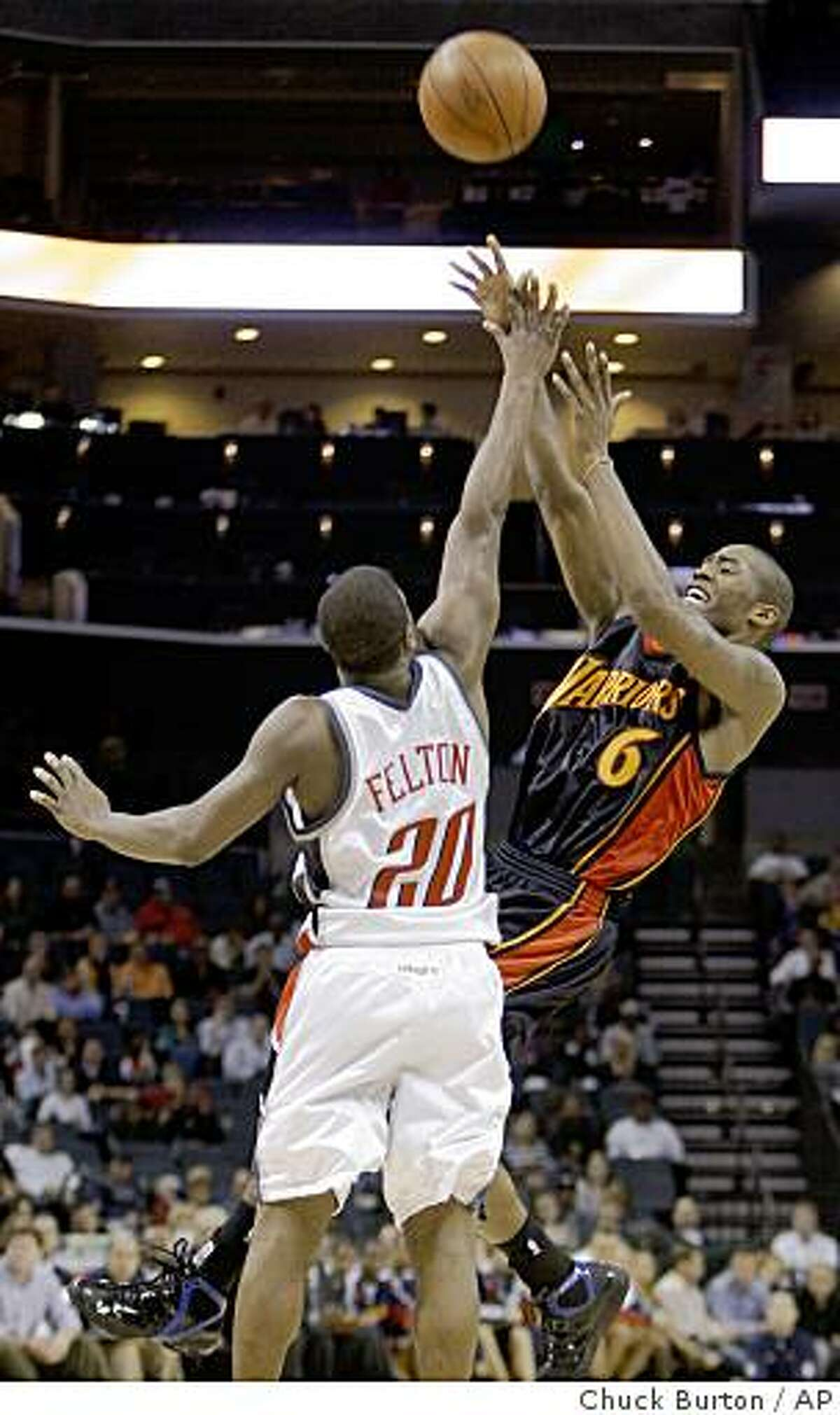 Golden State Warriors' Jamal Crawford (6) is fouled by Charlotte Bobcats guard Raymond Felton (20) during the second half of the Warriors' 110-101 win in an NBA basketball game in Charlotte, N.C., Saturday, Dec. 20, 2008. (AP Photo/Chuck Burton)