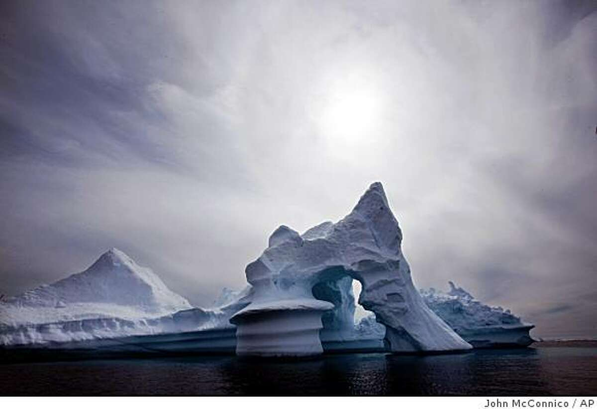 In this July 19, 2007 file photo, an iceberg melts off Ammassalik Island in Eastern Greenland.** FILE ** In this July 19, 2007 file photo, an iceberg melts off Ammassalik Island in Eastern Greenland. More than 2 trillion tons of land ice in Greenland, Antarctica and Alaska have melted since 2003, according to new NASA satellite data that show the latest signs of what scientists say is global warming. (AP Photo/John McConnico) Ran on: 12-17-2008 An iceberg melts off Greenland, which has suffered a major loss of land ice in the past five years, according to NASA satellite data. Ran on: 12-17-2008