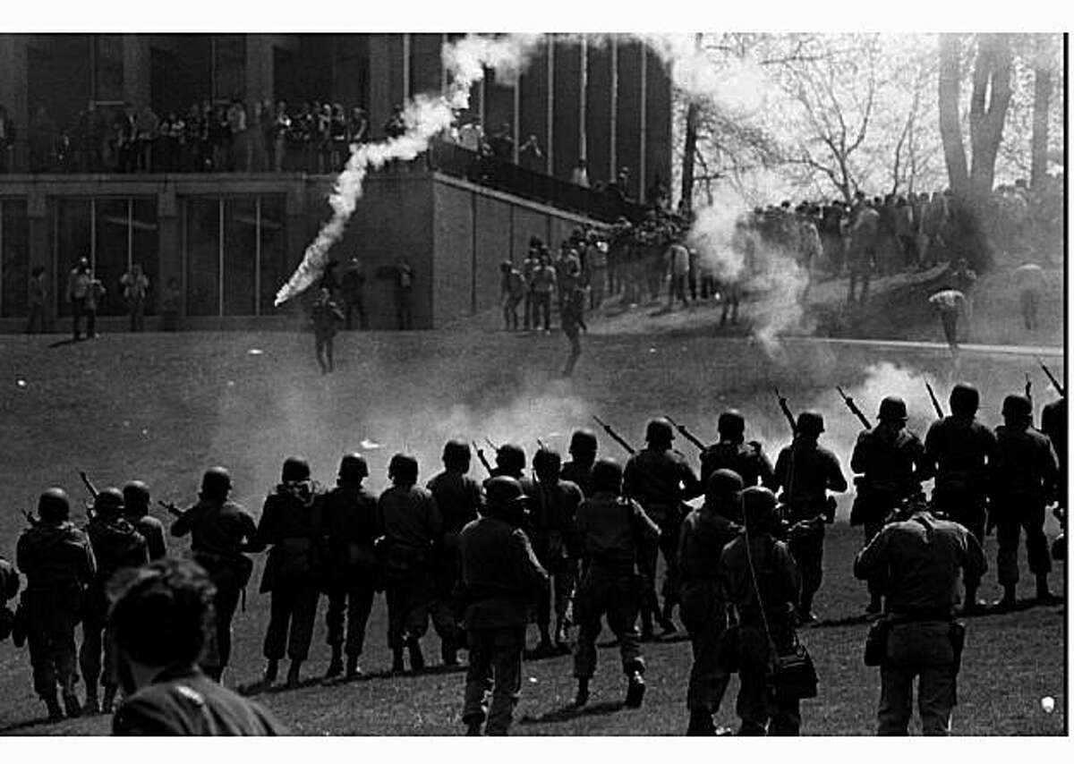 CLE04:KENT-ANNIVERSARY;KENT,OHIO,28APR95 - FILE PHOTO 04MAY70 - -Ohio National Guard move from the Commons toward students at Kent State University during a demonstration against the expansion of the Vietnam war into Cambodia May 4 1970. The shootings at Kent State came at a time when public opinion was making the Vietnam war the most unpoular in U.S. history. May 4 1995 marks the 25th anniversary of the shootings. cm/KSU Photo by Doug Moore REUTERS