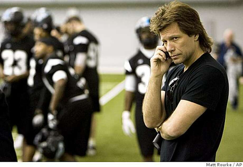** FILE ** In this Feb. 6, 2008 file photo, Philadelphia Soul arena football team co-owner and rock star entertainer Jon Bon Jovi is seen on the practice sidelines in Philadelphia.  The Arena Football League has canceled its 2009 season subject to agreement of the players union. The decision comes days after the AFL said next season had not been suspended. The AFL's owners voted against playing next season during a conference call Sunday night and announced the move Monday Dec. 15, 2008.(AP Photo/Matt Rourke, File) Photo: Matt Rourke, AP