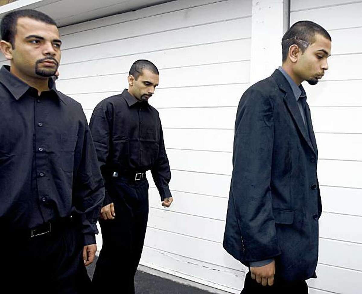Sunny Dhaliwal (far left) escorts his two brothers Kulbir (center) and Paul, both injured in the tiger attack, from the funeral services for 17-year-old Carlos Sousa, Jr. in San Jose, Calif. on Tuesday, Jan. 8, 2008. Sousa was killed in the Christmas Day tiger attack at the San Francisco Zoo.
