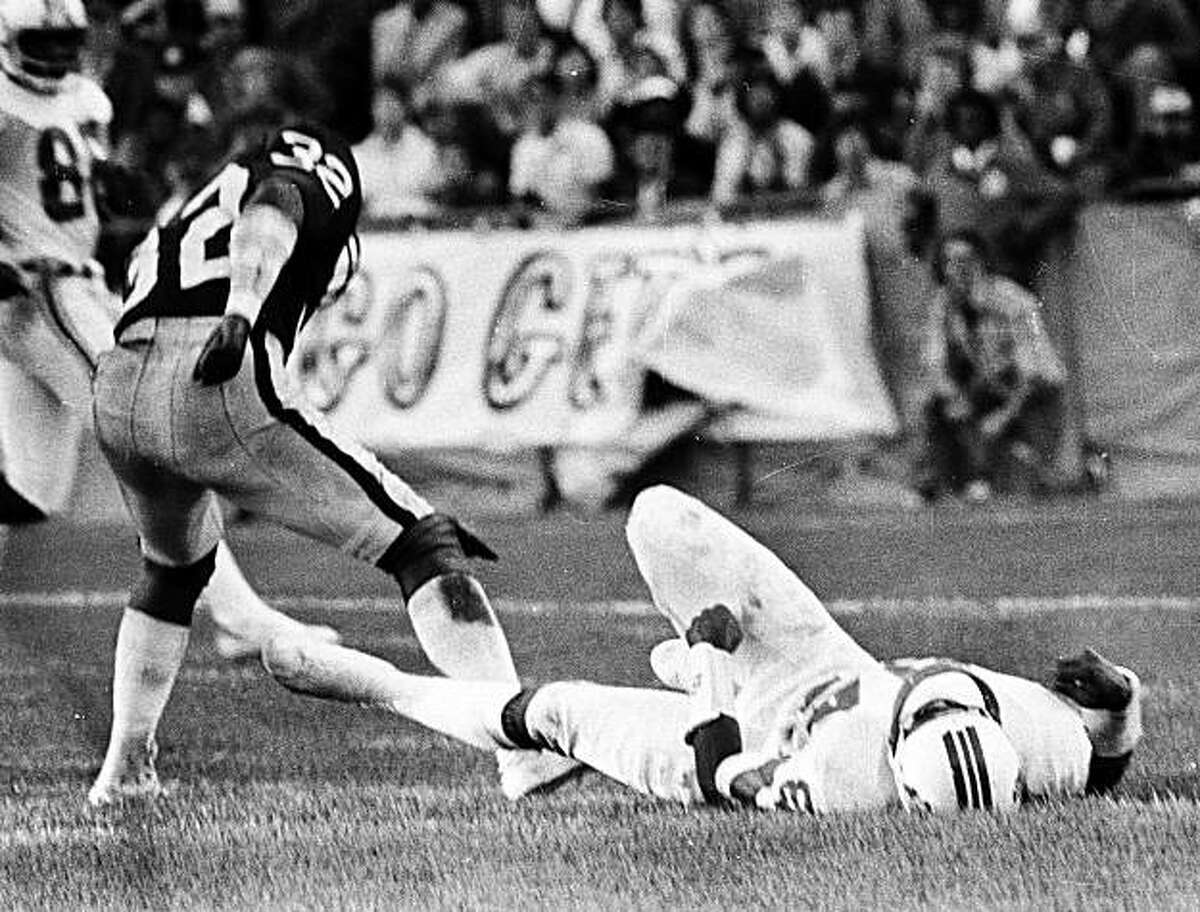 New England Patriots Darryl Stingley lays on the ground after a hit by Oakland Raiders Jack Tatum (32) during an NFL preseason football game in Oakland, Calif., Aug. 12, 1978. Stingley, who was paralyzed on the play nearly 30 years ago, died Thursday, April 5, 2007. He was 55.