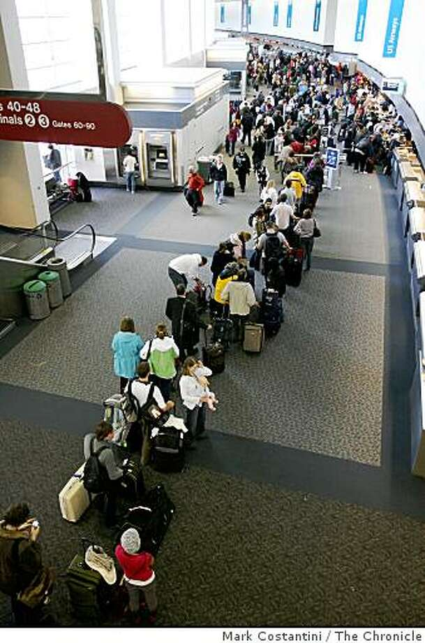 Travelers are delayed at Terminal One at SFO in Millbrae, Calif.  on Monday, December 22, 2008. Photo: Mark Costantini, The Chronicle