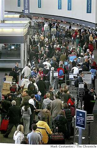 Travelers are delayed at Terminal 1 at SFO in Millbrae, Calif.  on Monday, December 22, 2008. Photo: Mark Costantini, The Chronicle