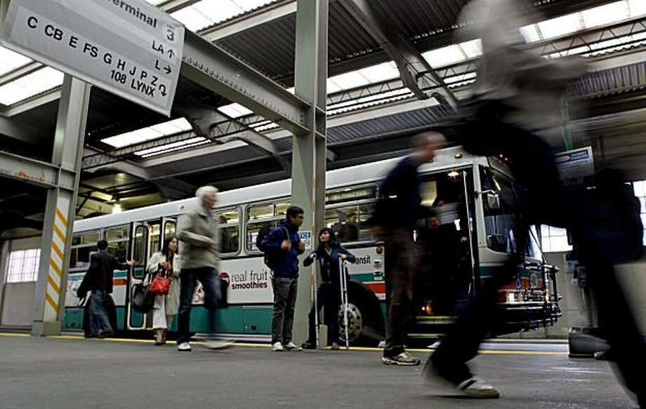 AC Transit riders arrive at the Transbay Terminal on Friday in San Francisco. Photo: Michael Macor, The Chronicle