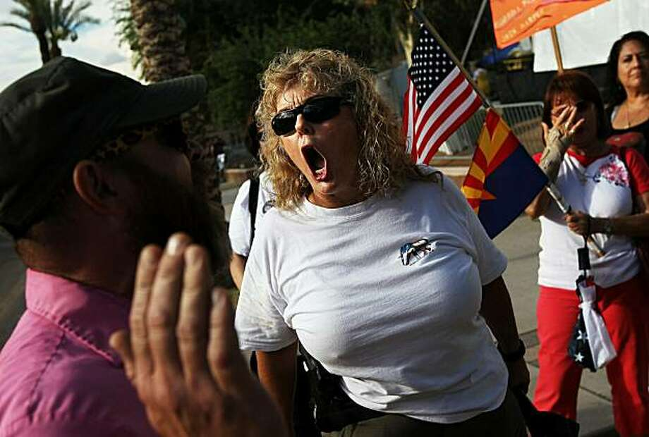 PHOENIX - JULY 28:  Tea Party activist Sharon Tinin, a supporter of Arizona's immigration enforcement law SB 1070 shouts at a law opponent after a judge blocked some controversial provisions of the law on July 28, 2010 in Phoenix, Arizona. U.S. District Court Judge Susan Bolton issued a preliminary injunction preventing several sections of Arizona's new immigration law from going into effect, at least until the courts have a chance to hear the full case. Photo: John Moore, Getty Images