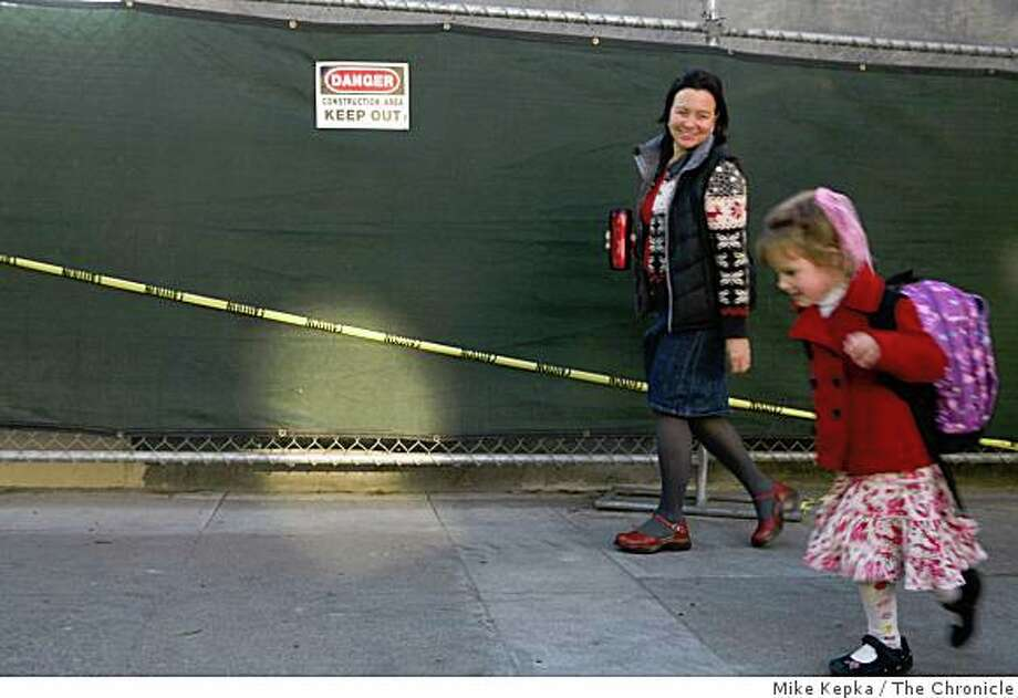 Jefferson Elementary School teacher, Loret Peterson with daughter Isabelle Oringer, 6, leave school grounds on, Friday Dec. 9, 2008 in San Francisco, Calif.  The school is expecting state bond money to complete a $6 million modernatization project. Photo: Mike Kepka, The Chronicle
