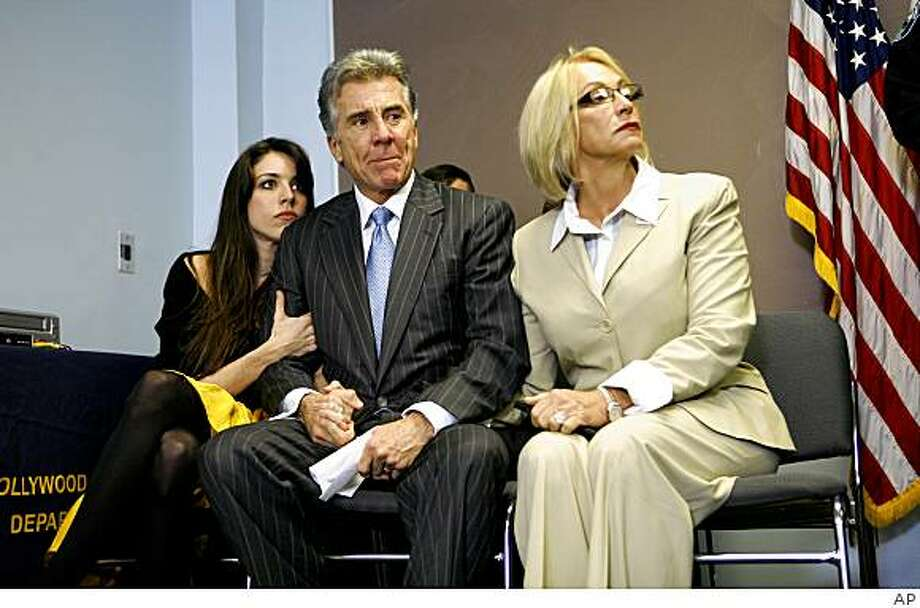 John Walsh and his wife, Reve, along their daughter, Meghan, left, listen as the Hollywood Police Department announces the conclusion of the investigation in to the death of their son, Adam, who was abducted and killed in 1981, during  a news conference in Hollywood, Fla. Tuesday, Dec. 16, 2008. (AP Photo) Photo: AP