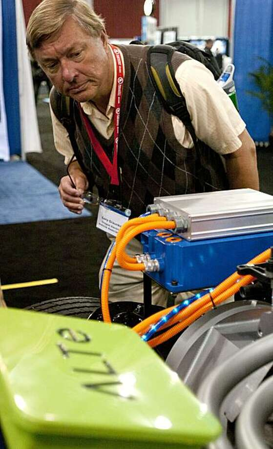 Gary Graunke of the Oregon Electric Vehicles Association inspects the ALTe exhibit at the Plug-In 2010 convention which hosts automakers and pioneers of technology in the electric vehicle industry at the San Jose McEnery Convention Center in San Jose, Calif., on Tuesday, July 27, 2010. Photo: Chad Ziemendorf, The Chronicle