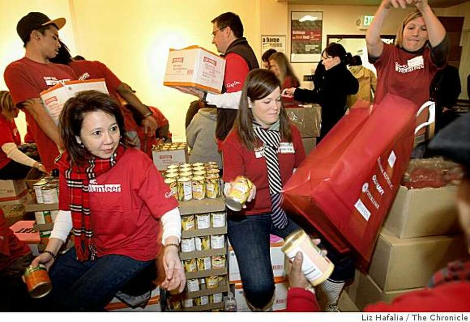 Myra Arangcon, left, and Melissa Swanson, right, volunteered to help Glide Memorial Church give out over 6,000 bags of groceries. Photo: Liz Hafalia, The Chronicle