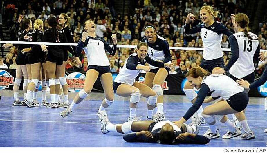 Penn State celebrates their 3-0 win over Stanford to win the 2008 NCAA national volleyball championship, Saturday, Dec 20, 2008, in Omaha, Neb. Photo: Dave Weaver, AP