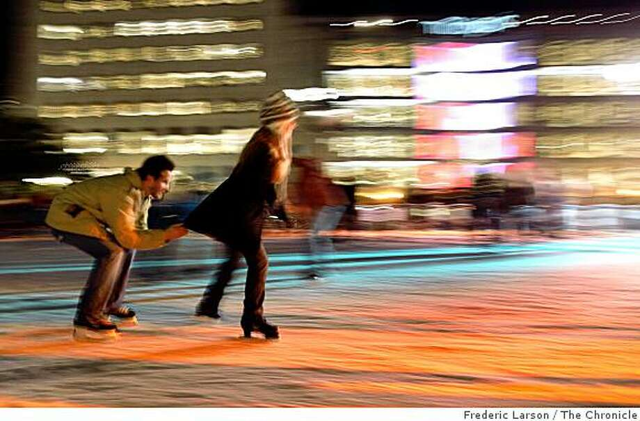 Ice skaters move around the Holiday Ice Skating Rink at San Francisco Union Square on the evening December 17. 2008. Photo: Frederic Larson, The Chronicle