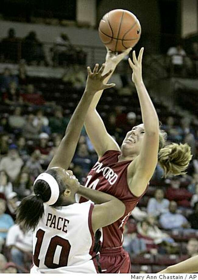Stanford's Kayla Pedersen, right, drives for the basket as South Carolina's C.J. Pace (10) tries to block during the first half of their NCAA college basketball game Friday, Dec. 19, 2008, at the Colonial Life Area in Columbia, S.C. (AP Photo/Mary Ann Chastain) Photo: Mary Ann Chastain, AP